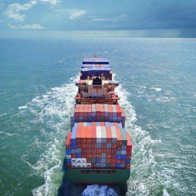 cargo ship at sea sailing towards horizon